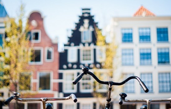 Beautiful canal houses and a bike in Amsterdam, Holland