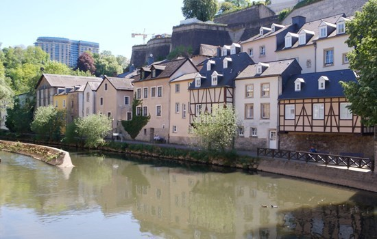 River in Luxembourg with ancient houses on the river bank