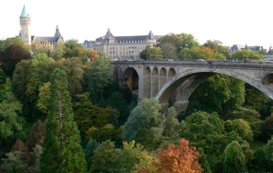 Adolphe Bridge crossing a green valley in Luxembourg City