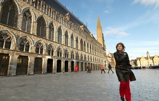 Woman in front of the In Flanders Fields Museum in Ypres, Belgium